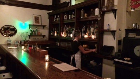 The long, sleek bar at ROUX.