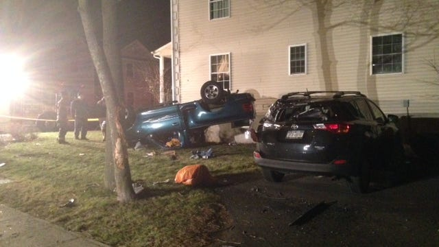 A Ford truck seen here rolled over against a Spring Valley home at 23 Lafayette Ave after the driver lost control of the vehicle, jumped the curb and flipped the pick-up early Sunday morning Dec. 28.