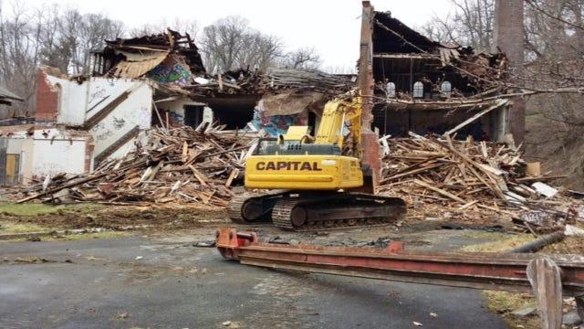 The owner of the former Brandreth pill factory in Ossining began illegally razing the historic landmark Tuesday morning.