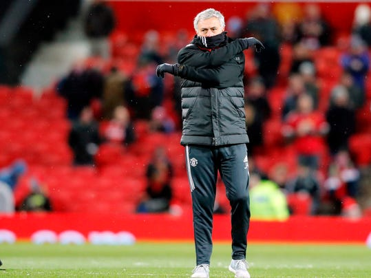 FILE- In this file photo dated Saturday, March 17, 2018, Manchester United head coach Jose Mourinho  ahead of the English FA Cup quarterfinal soccer match against Brighton, at the Old Trafford stadium in Manchester, England.  Manchester City has the chance to clinch the English Premier League title on upcoming Saturday April 7, by beating fierce rival Manchester United at Etihad Stadium in a local derby that Mourinho would have hoped to avoid. (AP Photo/Frank Augstein, FILE)