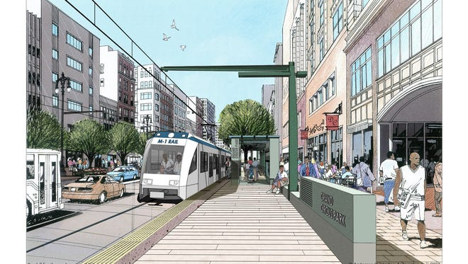 This artist rendering provided by the M-1 RAIL streetcar project shows the proposed 3.3-mile streetcar line along Woodward Avenue in Detroit. The project along the city's commercial corridor will bring light rail to one of the nation's few urban centers still without it. Transit is seen as crucial to attracting young professionals who are driving less and want an urban lifestyle.