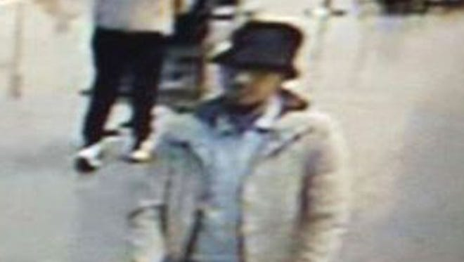 In this closeup from an image provided by the Belgian Federal Police in Brussels, a suspect in the March 22, 2016 bombing is shown on surveillance video at Brussels airport shortly before two deadly bombs went off. Police believe the suspect fled.