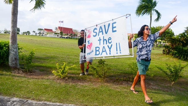 School students and others gather at Adelup on Dec. 11 to protest a plan to divert stormwater into Tumon Bay.