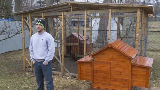 Angelo Koukoumis, Ocean Twp. is fighting with the town over his backyard chicken coop. - March 20, 2014-Ocean, NJ.