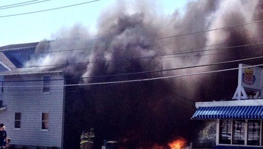 A fire broke out Monday afternoon in a three-story building next to LBI Pancake House in Ship Bottom.