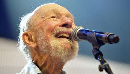 Pete Seeger performs during the Farm Aid 2013 concert at Saratoga Performing Arts Center in Saratoga Springs, N.Y., on Sept. 21, 2013. Seeger's life will be celebrated at the annual Clearwater Festival this summer. Seeger died in January at age 94, after surviving his wife Toshi by about seven months.
