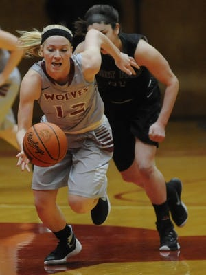 IU East's Adrianna Moore chases down a loose ball against Point Park. Only in its second year as a program, the Red Wolves are currently the only team in the KIAC without a conference loss.
