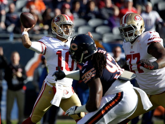 San Francisco 49ers quarterback Jimmy Garoppolo (10) throws during the first half of an NFL football game against the Chicago Bears, Sunday, Dec. 3, 2017, in Chicago. (AP Photo/Nam Y. Huh)