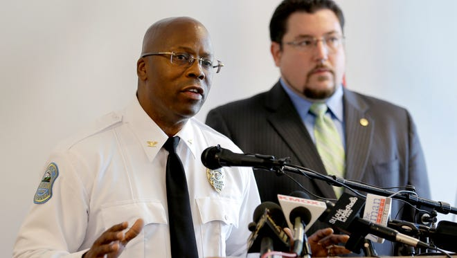 Andre Anderson speaks along side Ferguson mayor James Knowles III, right, during a news conference announcing Anderson as the interim police chief of the Ferguson Police Department Wednesday, July 22, 2015, in Ferguson, Mo. Anderson becomes the second interim chief since Police Chief Thomas Jackson stepped down in March.(AP Photo/Jeff Roberson)