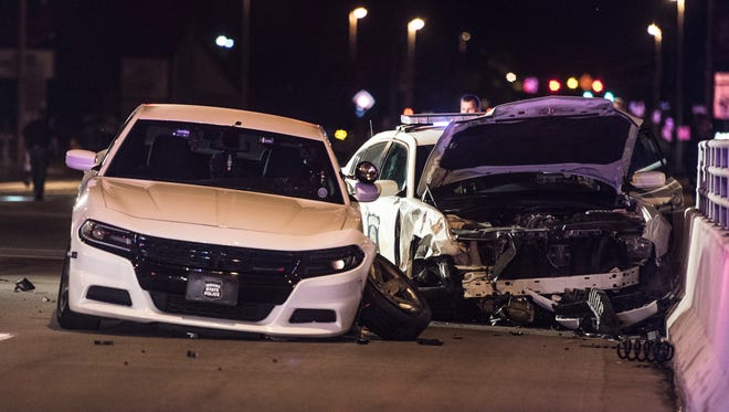 Two Indiana State Police vehicles crashed at the intersection of U.S. 40 and SW First Street early Saturday, June 17, 2017.