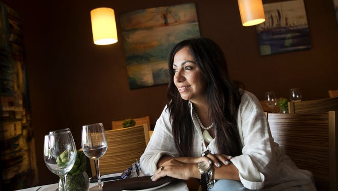 """Gloria Jordan owns two restaurants, La Trattoria Cafe Napoli and Mermaid Garden Cafe. Originally from Havana, Cuba, she has been in Southwest Florida for 20 years. She says immigrants are important to the fabric of American society and that """"America is the godmother of every country."""""""