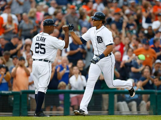 Detroit Tigers' Steven Moya, right, celebrates his solo home run against the Seattle Mariners with third base coach Dave Clark (25) iduringthe fourth inning of a baseball game in Detroit, Wednesday, June 22, 2016. (AP Photo/Paul Sancya)