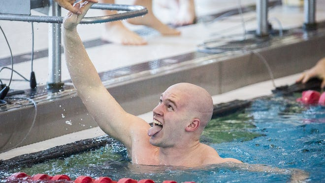 Delta's Jared Hunt celebrates after finishing the 50 freestyle event at Jay County High School Saturday, Feb. 18, 2017.