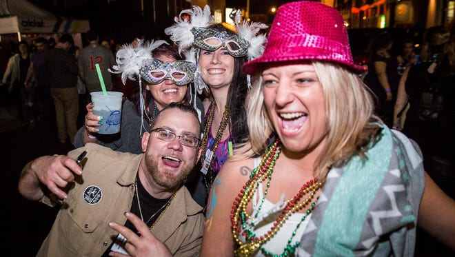 Hundreds attend Muncie Gras 2017 in downtown Muncie Saturday night. The event featured live music, drinks, games, burlesque shows, drag shows and other attractions.