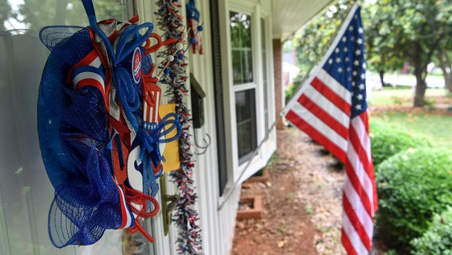 A patriotic wreath on the front door of Tim Clardy on Lindale Road Anderson, next door to Johnnie Ramey, on Wednesday.