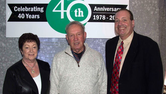 Pictured (from left) Carol, Tom and Sean Cleary celebrate Cleary Building Corp.'s 40th Anniversary at its Corporate World Headquarters in Verona, WI.