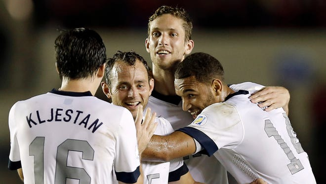 United States players from left Sacha Kljestan , Brad Davis , Clarence Goodson and Terrance Boyd celebrate the game-winning goal by Aron Johannsson during their 3-2 win over Panama in a World Cup qualifier at Estadio Rommel Fernandez.