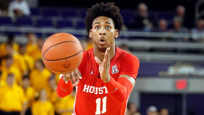Houston's Nate Hinton (11) passes the ball against East Carolina during the second half of an NCAA college basketball game in Greenville, N.C., Wednesday, Jan. 29, 2020.