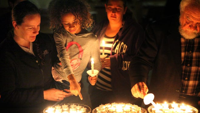 Two dozen people gathered to mourn the victims of addiction at the Church of Our Savior in Mount Auburn Sunday night. Candles were lit to remember those who were lost.