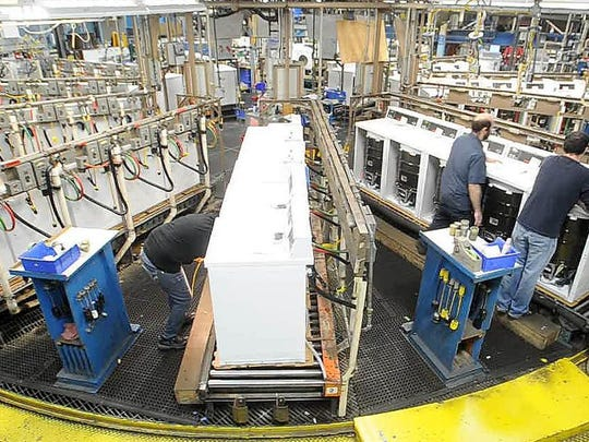 Workers at Alliance Laundry Systems test finished washers in 2014 before they are boxed up and shipped out. The company plans to break ground in June on a $62.6 million expansion that would ultimately add 200 jobs at its Ripon campus.