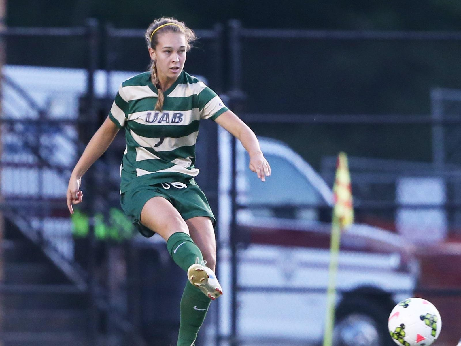 Gabrielle Brokamp from Walnut Hills High School delivers a pass for the UAB women's soccer team.