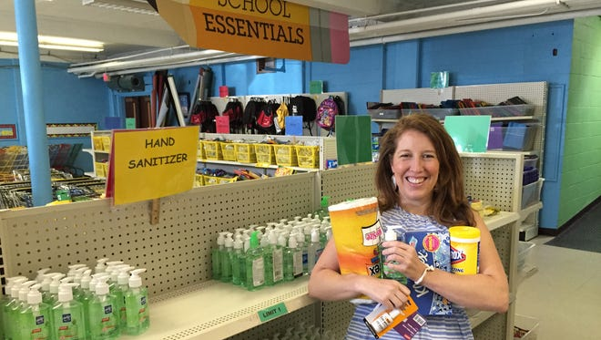 Kerry Conley shows off some of the most needed items, like paper towels, wipes, hand sanitizer and index cards, at the LP Pencil Box.