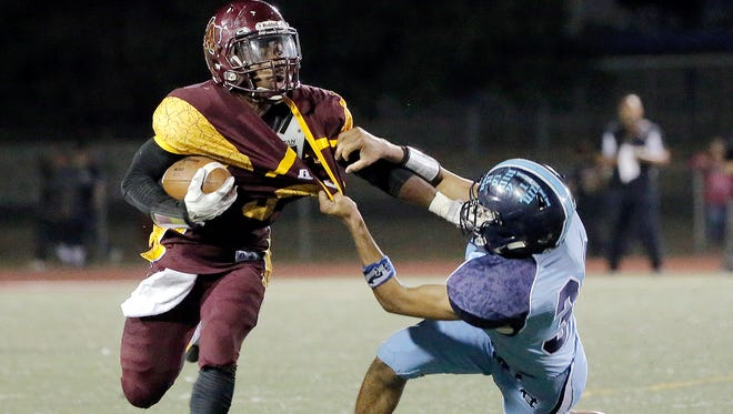 Andress running back Robert Wiggins denies Chapin linebacker Angel Carrillo of a tackle during the first half of their game Friday night at Andress High School. Chapin won the contest.