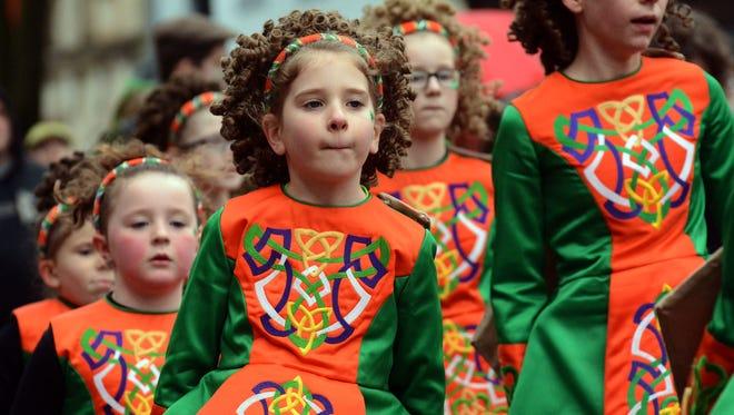 York's St. Patrick's Day parade went off Saturday between mild rain showers. Bil Bowden photos