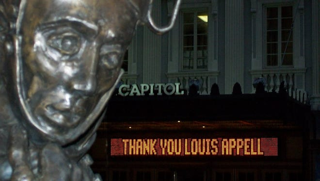 "The marque at the Strand Capitol Performing Arts Center displays a message — ""Thank you Louis Appell"" — reflecting the community's response to the beloved York businessman."