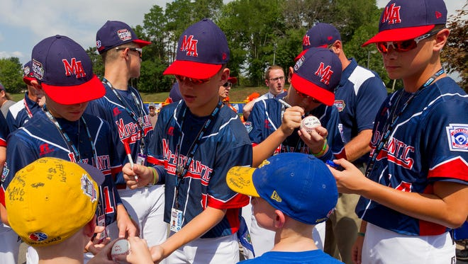 From left, Justin Ryan, Brody Raleigh, Conner Rush, and James Fellows of the Maine-Endwell Little League team, representing the Mid-Atlantic Region, sign autographs Thursday at midday after the opening ceremonies of the Little League World Series in Williamsport.