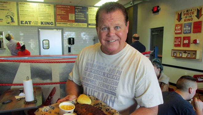 """Jerry """"The King"""" Lawler at King Jerry Lawler's Memphis BBQ Co., which opened Monday, Jan. 30, 2017, in Cordova, Tenn."""