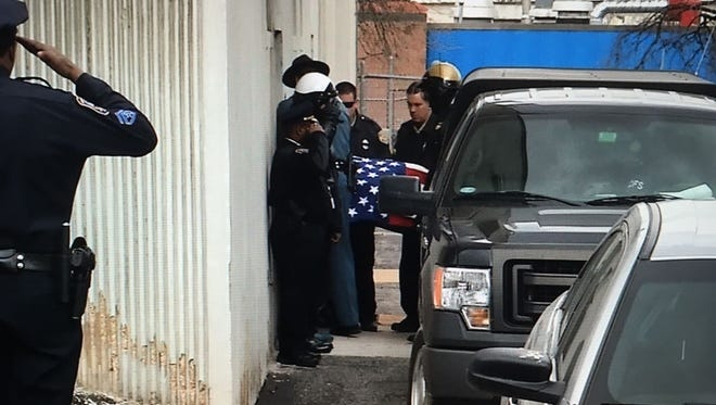 The body of corrections officer Sgt. Steven Floyd arrives at the Medical Examiner's office in Wilmington, Del., on Thursday, Feb. 2, 2017. Floyd was killed during a hostage situation at James T. Vaughn Correctional Center near Smyrna, Del.