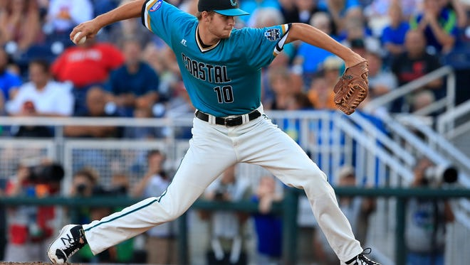 Coastal Carolina pitcher Jason Bilous throws against Texas Tech in the first inning of an NCAA College World Series baseball game in Omaha, Neb., Thursday, June 23, 2016. (AP Photo/Nati Harnik)