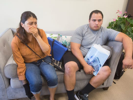 Norma Perez is overcome as she speaks of her husband's