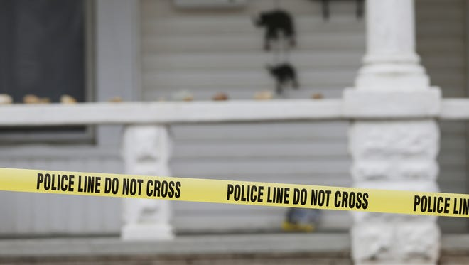 Crime tape surrounded a house in the 1000 block of Heath Street after a man was shot Feb. 5.