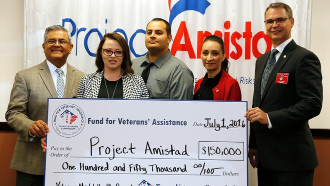 Xavier Banales, CEO of Project Amistad, from left; Andrea Ramirez, chief operating officer for Social Services at Project Amistad; Fernando Reyna, Project Amistad veteran counselor; Celia Garcia, Project Amistad program manager; and Charles Catoe, director of the Texas Veterans Commission Fund for Veterans' Assistance, presented the organization with a $150,000 check to be used in Project Amistad's new veteran's mental health services program. The money will be used to provide services to about 200 veterans and their families in the El Paso area.