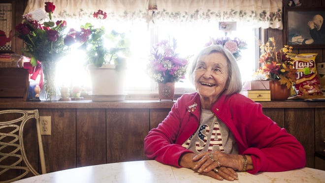 Lillian Sharette recounts stories from her century of life in her kitchen Wednesday. She celebrated her 100th birthday on Oct. 11 with a party at the Senior Center.