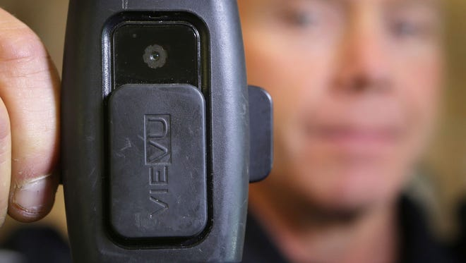 Eugene Police Sgt. Larry Compton displays his body camera.