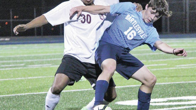 Bartlesville High School veteran soccer warrior Dylan McCoy, right, battles for ball control during action earlier in his career. McCoy will be counted on for a big impact next season as an attacker. Mike Tupa/Examiner-Enterprise