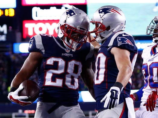 Patriots running back James White (28) celebrates his