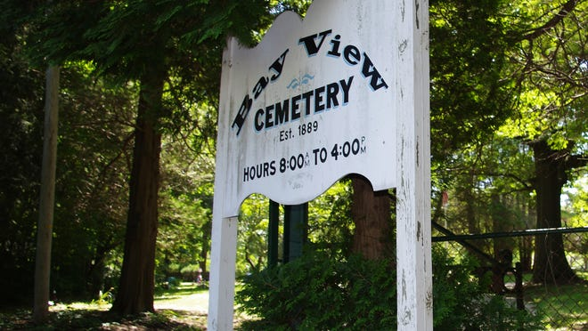 The sign marking the entrance to Bay View Cemetery in Middletown.