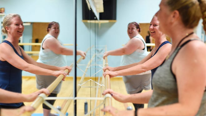 Erica Downie, center, jokes with Stephanie Evans, left, and Anne Ramsay during a barre class at B*Dazzled Dance Studio. Instructor Tara Miller will lead the Barre Now, Wine Later class at Naylor Wine Shoppe Aug. 19.