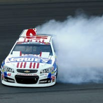 Jimmie Johnson spins in Turn 4 during the NASCAR Sprint Cup series auto race Sunday at Charlotte Motor Speedway in Concord, N.C.