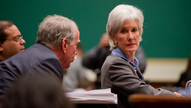 Health and Human Services Secretary Kathleen Sebelius listens to a member of her staff during a hearing before the House Energy and Commerce Committee about the difficulties plaguing the implementation of the Affordable Care Act on Capitol Hill.