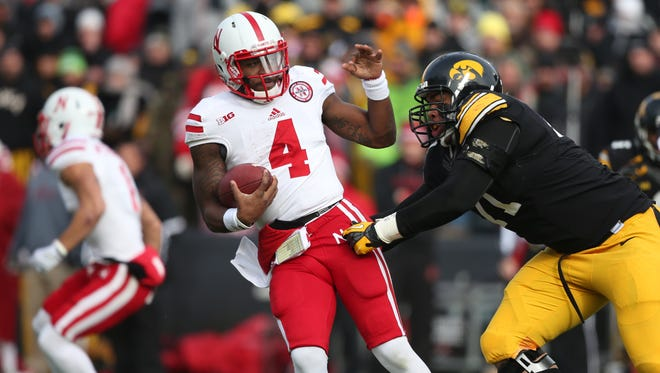 Iowa defensive lineman Carl Davis comes up with a sack on Nebraska quarterback Tommy Armstrong Jr. during Friday's Big Ten Conference game.