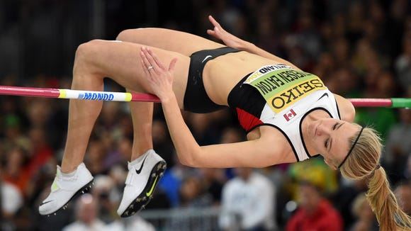 Mar 18, 2016; Portland, OR, USA; Brianne Theisen Eaton (CAN) clears 6-0 3/4 (1.85m) in the pentathlon high jump during the 2016 IAAF World Championships in Athletics at the Oregon Convention Center. Mandatory Credit: Kirby Lee-USA TODAY Sports