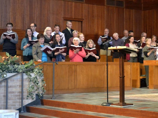 A choir that included members of the Northeastern Wisconsin Chapter of the American Guild of Organists sings during an organ concert and festival of hymns featuring Concordia University music professor John Behnke at First Presbyterian Church in Neenah on Sunday, April 10, 2016. The local chapter is hosting a benefit organ concert at 2 p.m. Sunday, May 1, at First United Methodist Church in downtown Green Bay.