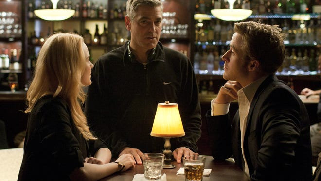 Director George Cloone  talks to actors Evan Rachel Wood and Ryan Gosling before shooting a scene at The Stand in Mount Lookout.
