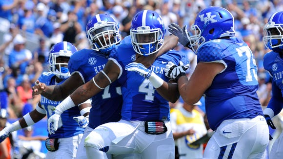 UK's Michael Horton celebrates after scoring on an 18-yard touchdown run against UT Martin, Saturday, Aug. 30, 2014 at Commonwealth Stadium in Lexington. Photo by Tim Webb, Special to the CJ