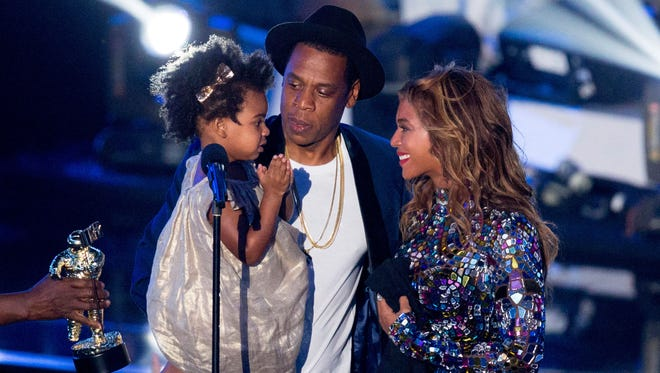 Jay Z and Beyonce with daughter Blue Ivy Carter onstage during the 2014 MTV Video Music Awards at The Forum on August 24, 2014 in Inglewood, California.